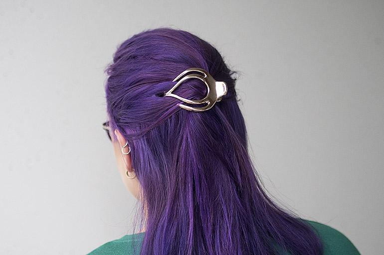 arkikampaus hiusklipsillä